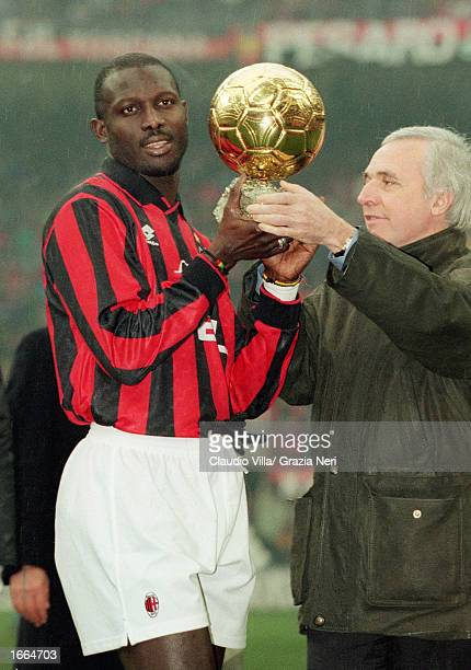 George Weah of AC Milan is presented the 'European Footballer of the Year' award before the Serie A match between AC Milan and Sampdoria held on...