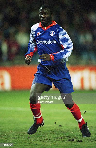 George Weah of Paris St Germain in action during a European Cup Winners Cup match held in 1994 at the Parc des Princes in Paris France