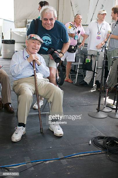 George Wein founder of The New Orleans Jazz and Heritage Festival with music photographer David Redfern backstage watching Pete Seeger perform at the...