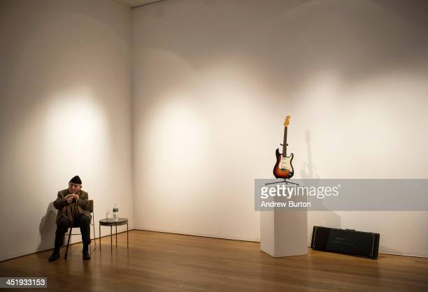 George Wein founder of the Newport Folk and Jazz Festivals sits next to the Fender Stratocaster electric guitar played by musician Bob Dylan on July...