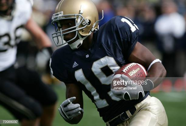 George West of the Notre Dame Fighting Irish rushes the ball for an 11 yard touchdown in the first quarter against the Purdue Boilermakers September...