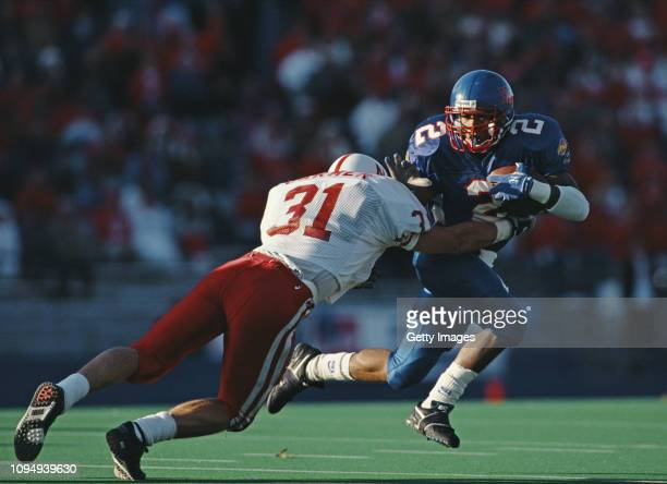 George White Running Back for the University of Kansas Jayhawks is tackled by Steve Carmer Defensive Back for the University of Nebraska Cornhuskers...