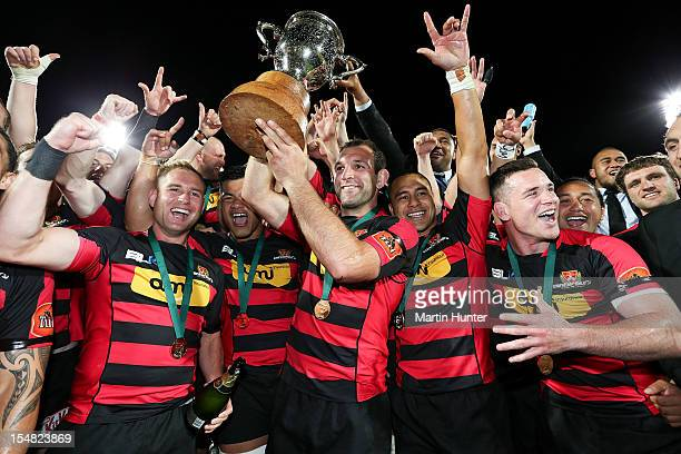 George Whitelock holds aloft the ITM Cup with his team mates after the ITM Cup final match between Canterbury and Auckland at AMI Stadium on October...