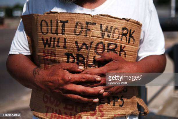 George who is homeless panhandles along a street in Lawrence on August 16 2019 in Lawrence Massachusetts Lawrence once one of America's great...