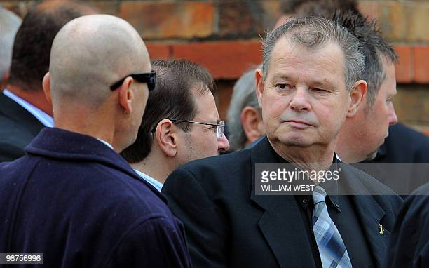 George Williams , father of slain gangland killer Carl Williams, speaks to a mourner after the funeral service for his son, in Melbourne on April 30,...