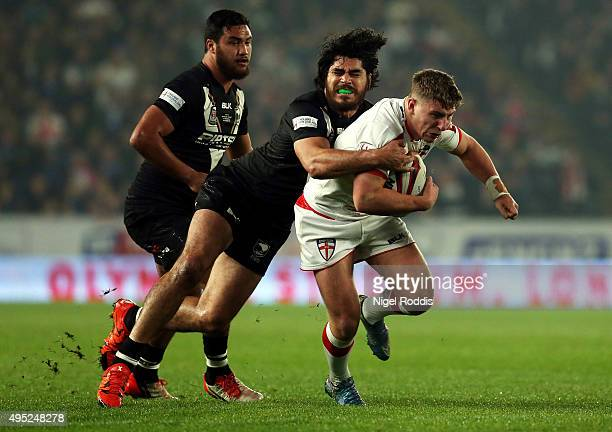 George Williams of England tackled by Tohu Harris of New Zealand during the International Rugby League Test Series match between England and New...