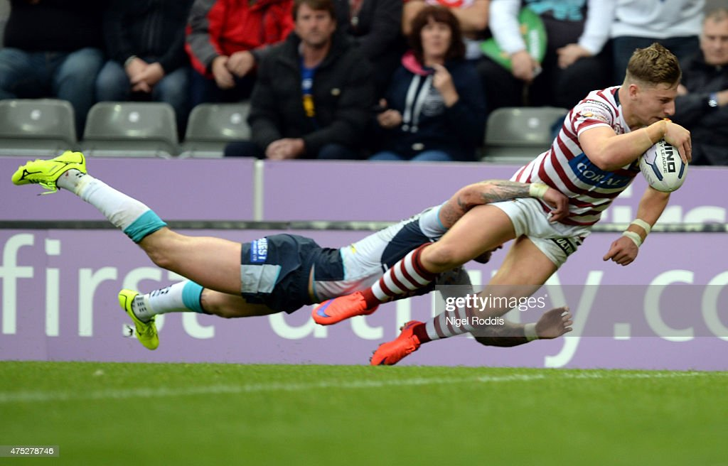 George Williams (R) of Wigan Warriors scores a try during the Super League match between Leeds Rhinos and Wigan Warriors at St James' Park on May 30, 2015 in Newcastle upon Tyne, England.
