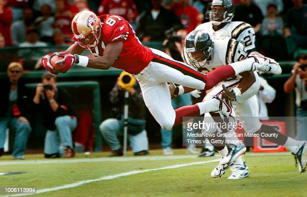 George Wolf 11/23/97 SMC Times Sports#13#13Terrell Owens does a theatric dive into the end zone in the first half for the Niners first touchdown...