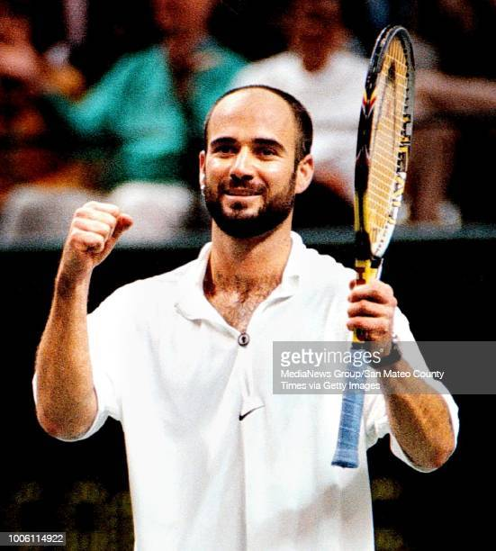 George Wolf 2/15/98 SMCT Sports#13#13Andre Agassi raises his fists in triumph after upsetting world No 1 Pete Sampras in the finals of the Sybase...