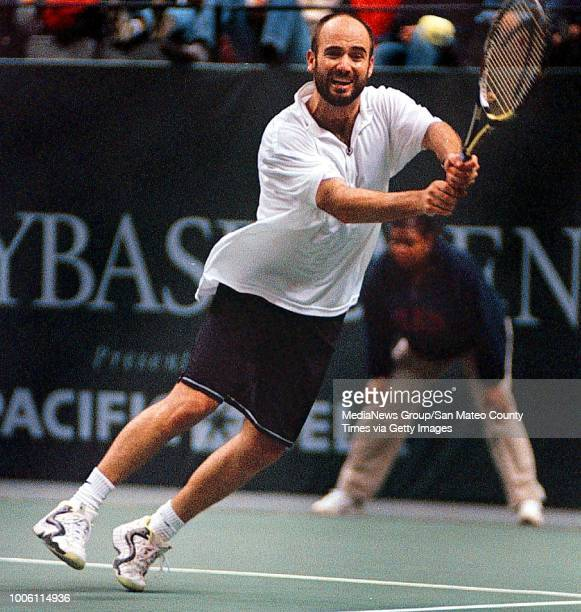 George Wolf 2/15/98 SMCT Sports#13#13Andre Agassi stretches wide for a backhand service return during his 62 64 upset win in the finals of the Sybase...