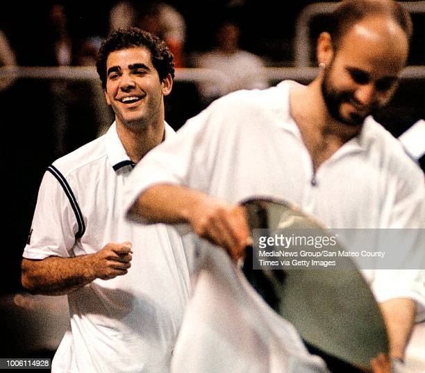 George Wolf 2/15/98 SMCT Sports#13#13Pete Sampras can't help but laugh after Andre Agassi during the trophy presentation suggested he should marry...