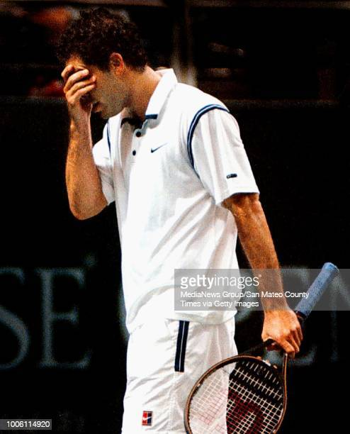 George Wolf 2/15/98 SMCT Sports#13#13Pete Sampras the world's No 1 tennis player seemingly can't bear to watch as he lost in straight sets to Andre...