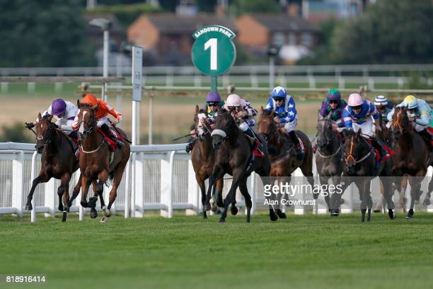 George Wood riding Finsbury Park win The Wolseley Novice Auction Stakes at Sandown Park racecourse on July 19 2017 in Esher England