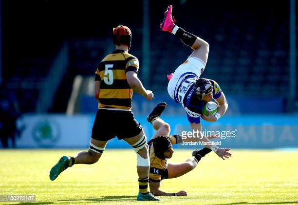 George Worboys of Bath u18's is tackled by Simone Panella of Wasps u18's during the 3/4th Place Playoff match between Bath U18's and Wasps U18's...
