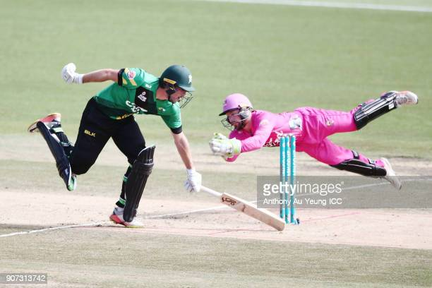 George Worker of the Stags makes his ground as Tim Seifert of the Knights goes for the run out during the Super Smash Grand Final match between the...