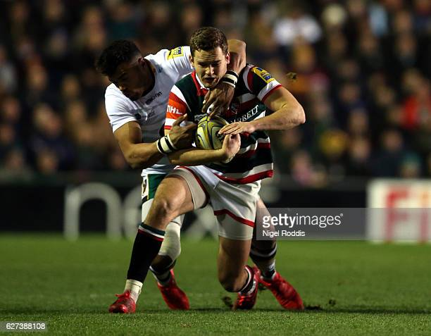 George Worth of Leicester Tigers tackled by Luther Burrell of Northampton Saints during the Aviva Premiership match between Leicester Tigers and...