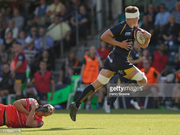 George Worth of Leicester Tigers takes off the boot of Ted Hill of Worcester Warriors during the Premiership Rugby Cup First Round match between...
