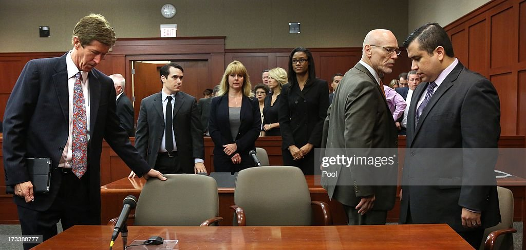 George Zimmerman (R) arrives with his defense team, Mark O'Mara (L) and Don West (C), waiting for the jury to return from deliberations in Seminole circuit court July 13, 2013 in Sanford, Florida. Judge Debra Nelson has ruled that the jury can also consider a lesser manslaughter charge along with the second-degree murder charge in the shooting death of unarmed teenager, Trayvon Martin.