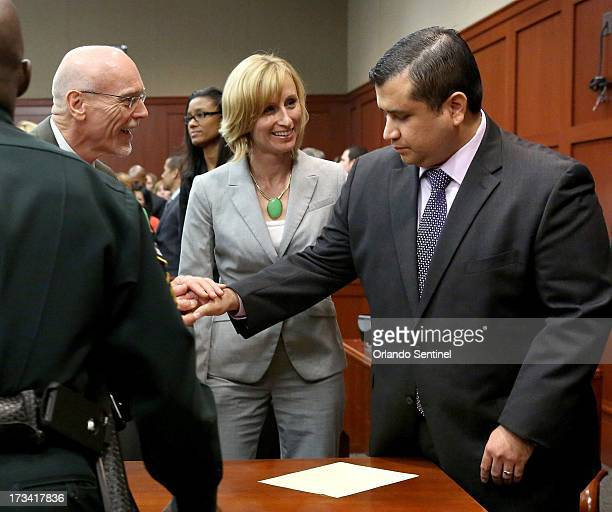 George Zimmerman is congratulated by his defense team after being found not guilty on the 25th day of Zimmerman's trial at the Seminole County...