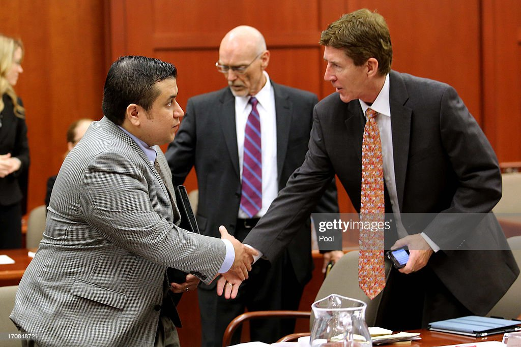 George Zimmerman (L) is greeted by defense attorneys Mark O'Mara (R) and Don West as he arrives in Seminole circuit court on the eighth day of his trial June 19, 2013 in Sanford, Florida. Zimmerman is charged with second-degree murder for the February 2012 shooting death of 17-year-old Trayvon Martin.