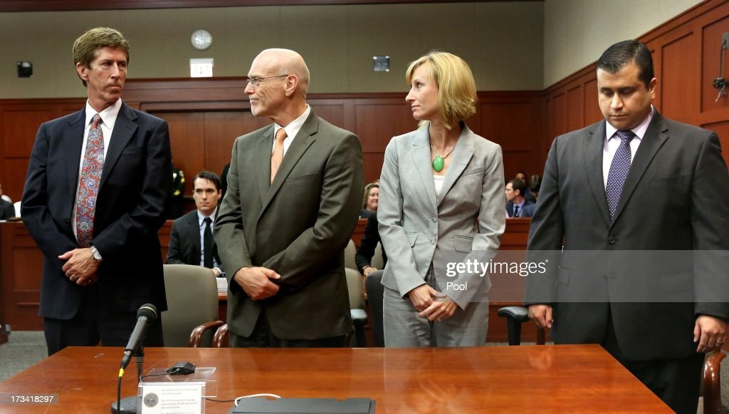 George Zimmerman (R) looks down at the moment the verdict of not guilty is read as his defense co-counsel, Don West (2L) and Lorna Truett (2R), look at Zimmerman's lead defense attorney Mark O'Mara, on the 25th day of his trial at the Seminole County Criminal Justice Center July 13, 2013 in Sanford, Florida. Zimmerman was charged with second-degree murder in the 2012 shooting death of Trayvon Martin.
