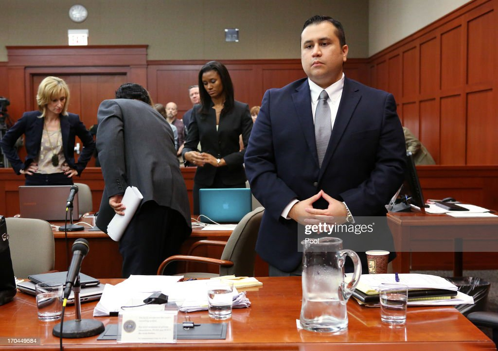 George Zimmerman (R) stands at the start of the fourth day of his murder trial in Seminole circuit court June 13, 2013 in Sanford, Florida. Jury selection continues in Zimmerman's second-degree murder trial for the shooting death of the unarmed teenager Trayvon Martin.