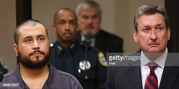 George Zimmerman the acquitted shooter in the death of Trayvon Martin stands with his defense counsel Jeff Dowdy during a firstappearance hearing on...