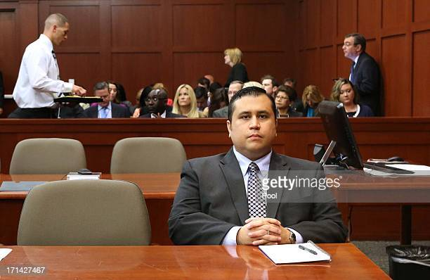 George Zimmerman waits for his defense counsel to arrive in Seminole circuit court on the 11th day of his trial June 24 2013 in Sanford Florida Today...