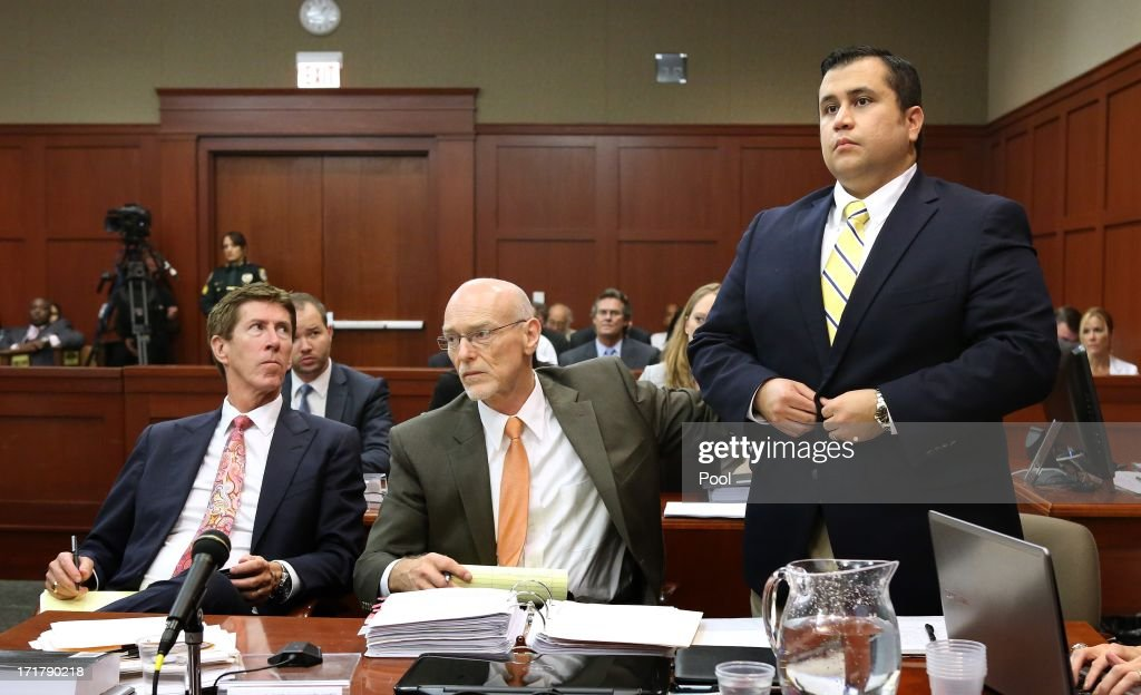 George Zimmerman (R), with his attorneys, Mark O'Mara (L) and Don West (C) appear in court during the 15th day of his murder trial in Seminole circuit court June 28, 2013 in Sanford, Florida. Zimmerman is charged with second-degree murder for the February 2012 shooting death of 17-year-old Trayvon Martin.