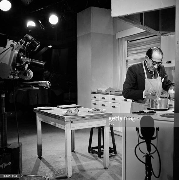 Georges Adet in front of his stoves prepares a recipe