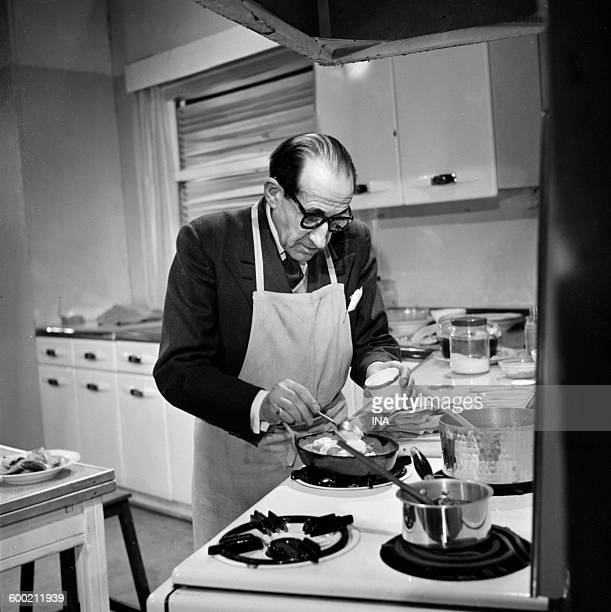Georges Adet in front of his stoves preparing a recipe