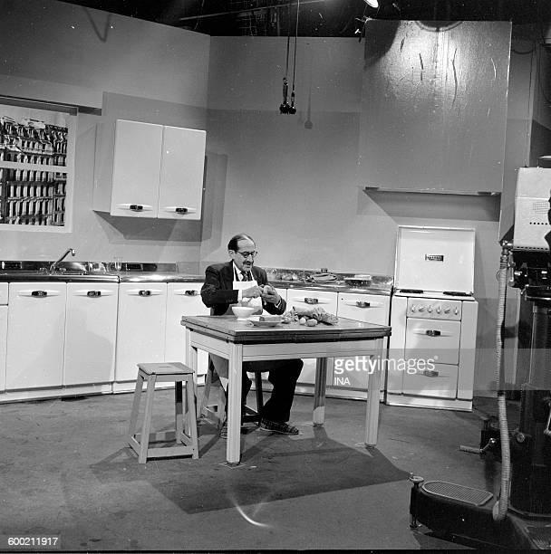 Georges Adet prepares a recipe