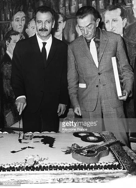 Georges Brassens cutting his cake with Marcel Ayme in France