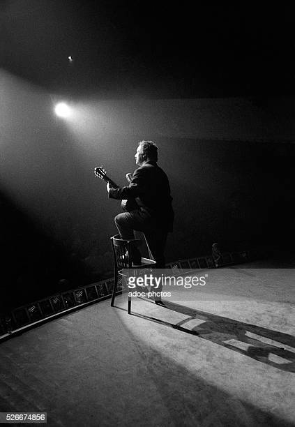Georges Brassens French singersongwriter and poet During a concert at Bobino in Paris In 1957