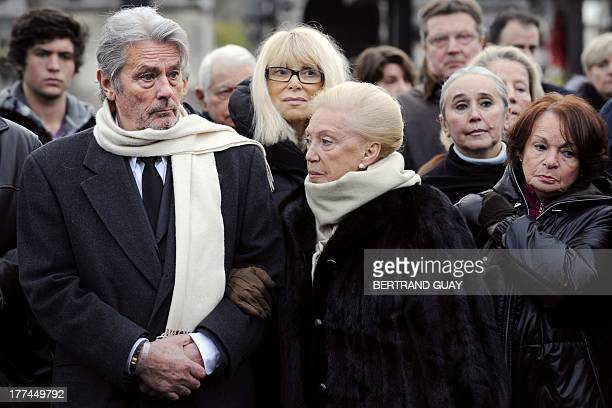 Georges Cravennes' former assistant Yvette Camp holds french actor Alain Delon's arm next to actresses Mireille Darc Ingrid Therond and Francoise...