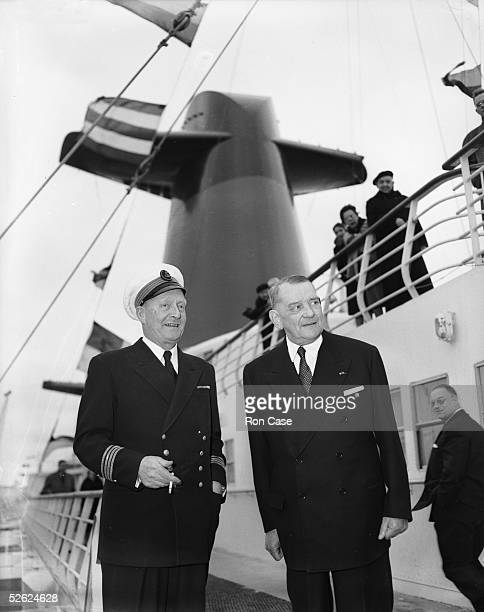 Georges Croisile captain of the new 1035foot French liner France with former French president Rene Coty on the ship's bridge at Southampton where it...