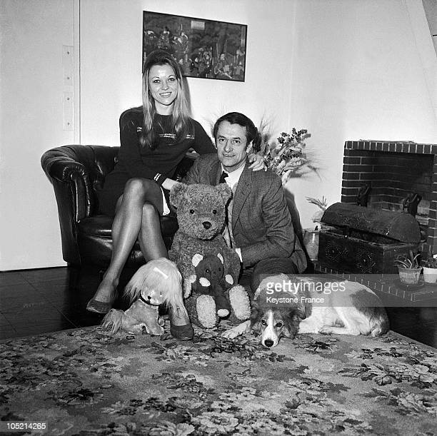 Georges De Caunes And His Wife AnneMarie Carmentrez In Their Apartment With Their Dog Eider In France On January 3 1968