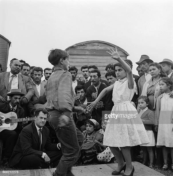 Georges de Caunes assists a demonstration of dance flamenco by children gypsies within the framework of the program 'Live from SaintesMariesdelaMer'