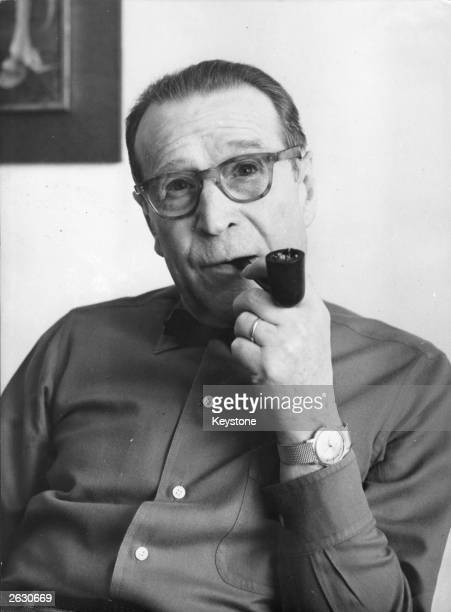 Georges Joseph Christian Simenon , the Belgian born French novelist, remembered for his novels featuring Jules Maigret, the pipe smoking, persistent...