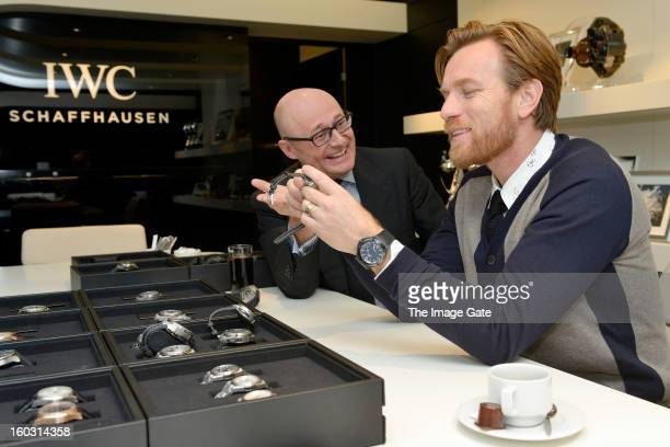 Georges Kern and Ewan McGregor visit the IWC booth during the Salon International de la Haute Horlogerie 2013 at Palexpo on January 23, 2013 in...