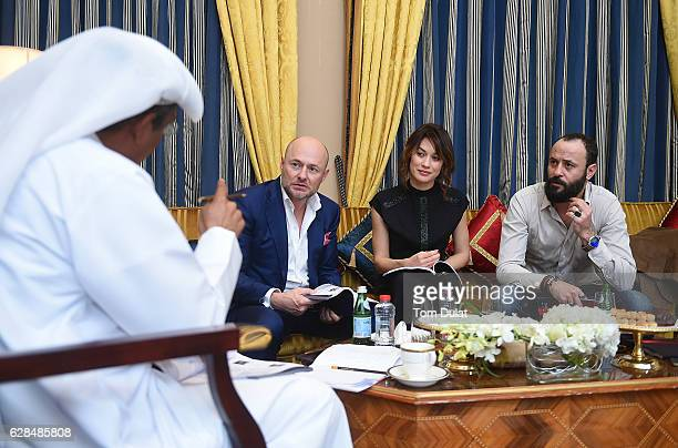 Georges Kern CEO IWC Schaffhausen Olga Kurylenko and Ali Suliman attend the jury meeting of the fifth IWC Filmmaker Award at the 13th Dubai...