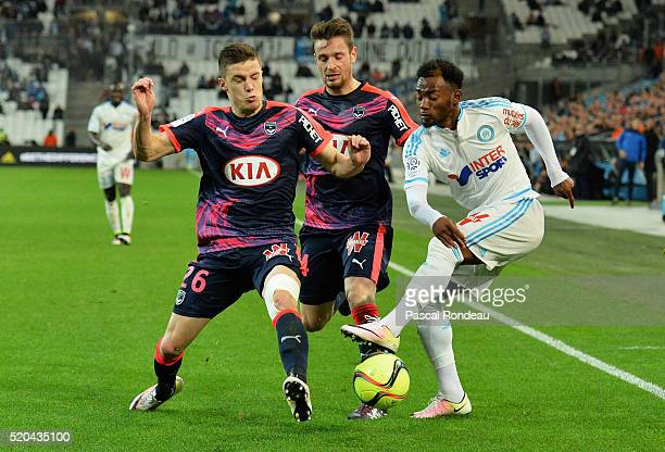 Georges Kévin Nkoudou Mbida from Marseille kick the ball in front of Frédéric Guilbert and Mathieu Debuchy from Bordeaux during the French League 1...