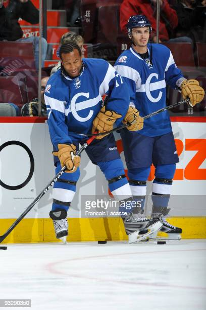 Georges Laraque and Maxim Lapierre of the Montreal Canadiens warm up before the NHL game against the Detroit Red Wings on November 21 2009 at the...