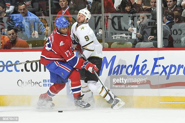 Georges Laraque of Montreal Canadiens collides with Mike Modano of the Dallas Stars during the NHL game on January 14 2010 at the Bell Centre in...