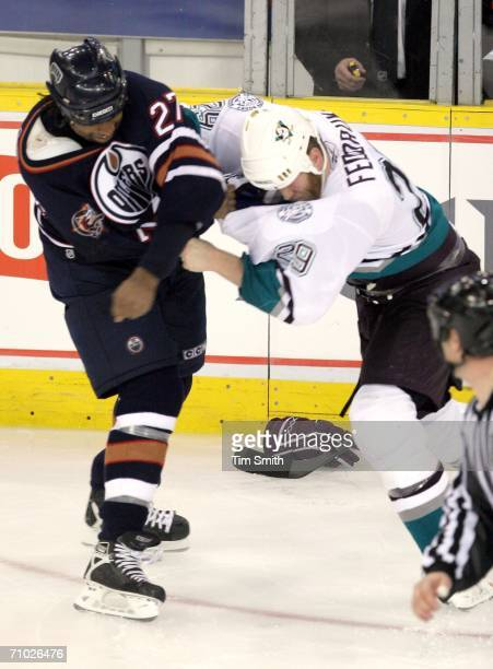 Georges Laraque of the Edmonton Oilers exchanges blows with Todd Fedoruk of the Mighty Ducks of Anaheim in the third period in game three of the...