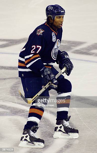 Georges Laraque of the Edmonton Oilers eyes the play as he skates near center ice against the San Jose Sharks at the Skyreach Centre on October 9...