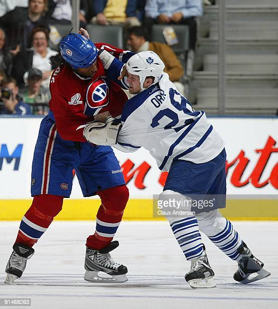 Georges Laraque of the Montreal Canadiens and Colton Orr of the Toronto Maple Leafs battle in a game on October 1 2009 at the Air Canada Centre in...