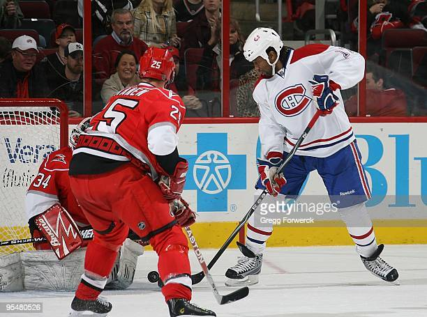 Georges Laraque of the Montreal Canadiens attempts to tip the puck in the net during a NHL game against the Carolina Hurricanes on December 23 2009...