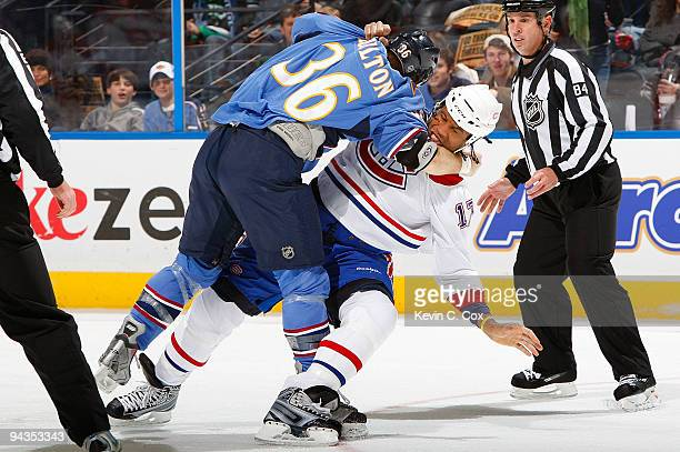 Georges Laraque of the Montreal Canadiens falls to the ice while fighting with Eric Boulton of the Atlanta Thrashers at Philips Arena on December 12...