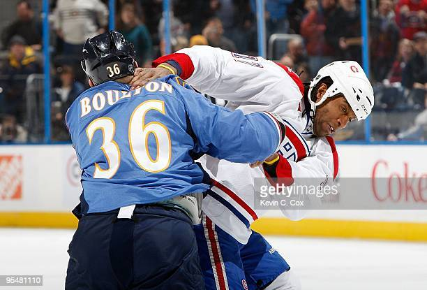Georges Laraque of the Montreal Canadiens fights with Eric Boulton of the Atlanta Thrashers at Philips Arena on December 12 2009 in Atlanta Georgia